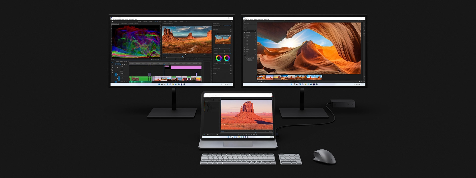 Surface Laptop Studio docked to two larger monitors being used to edit video.