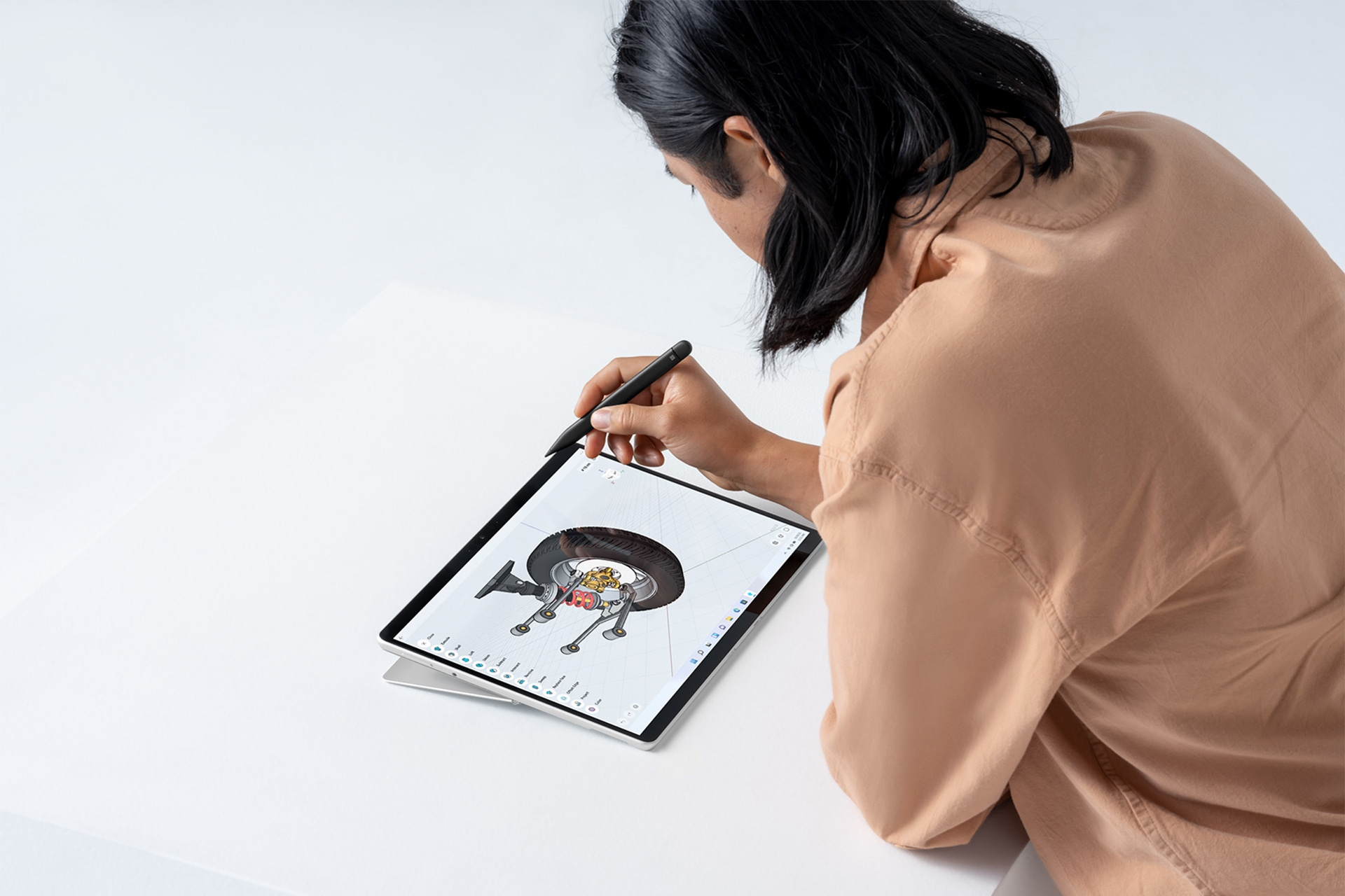 A person using Surface Pro 8 and Surface Slim Pen 2 to design.