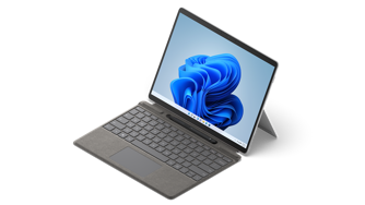 Surface Pro X shown with Pro Signature Keyboard and Slim Pen 2.