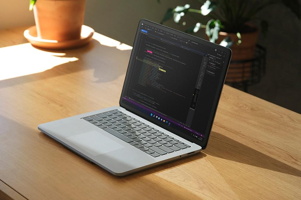 Surface Laptop Studio sitting atop desk in Laptop Mode