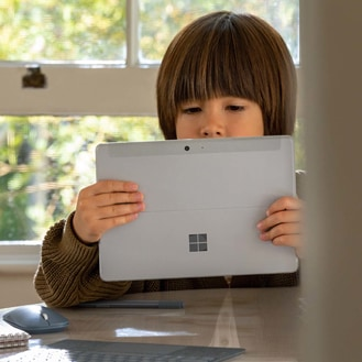 A child does schoolwork on Surface Go 2