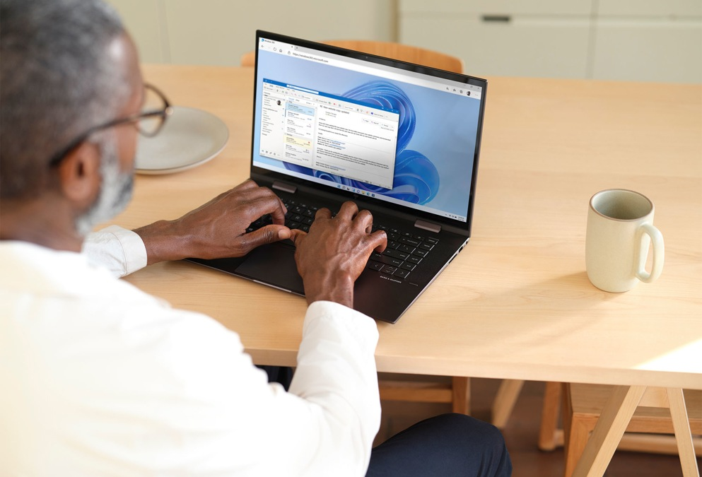 A person using Microsoft Teams on their laptop at home.