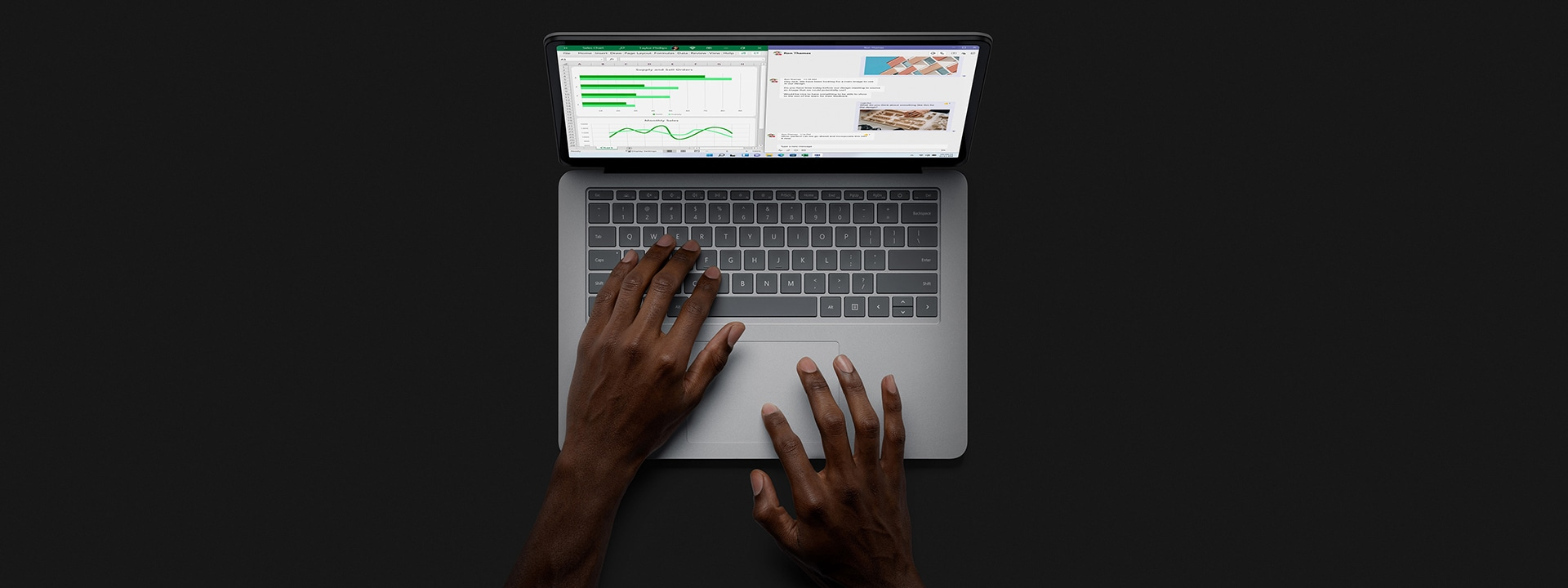 A person uses Surface Laptop Studio in laptop mode.