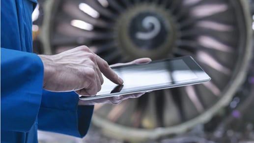 A person holding and using a tablet.