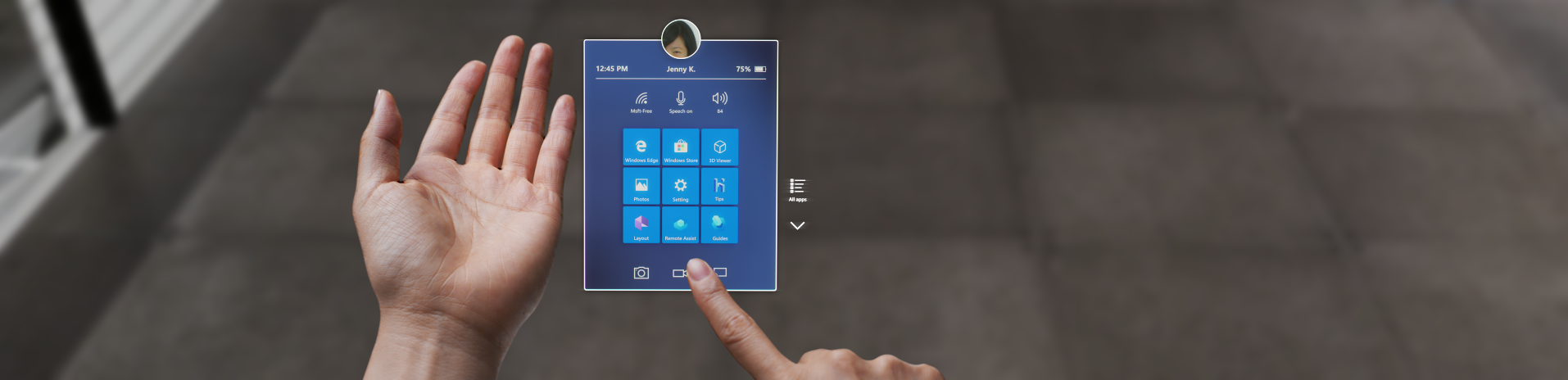 A person using their hand to navigate a menu using HoloLens 2.