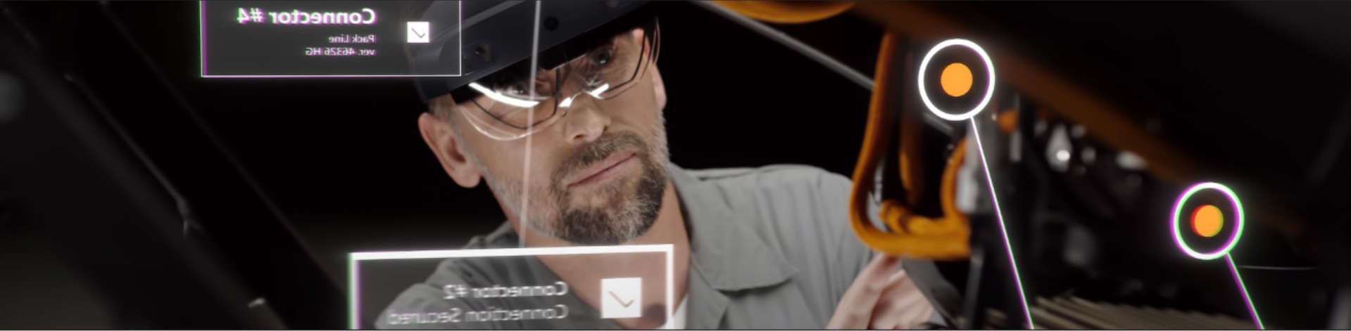 A person using HoloLens 2 to work on a machine.