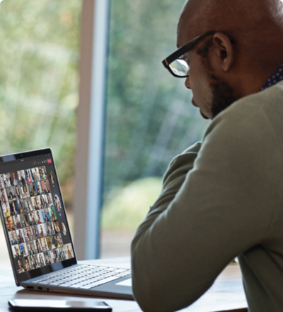 A person using a laptop to participate in a Teams video call.