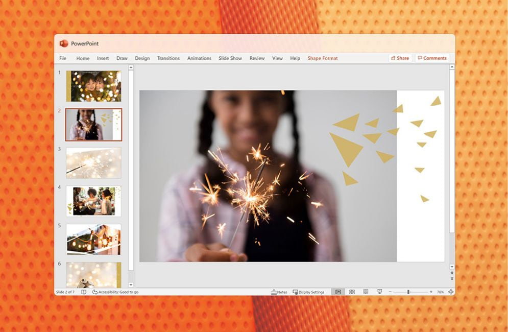 A PowerPoint presentation featuring a child holding up paper snowflakes.