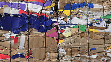 Compressed material, ready for recycling