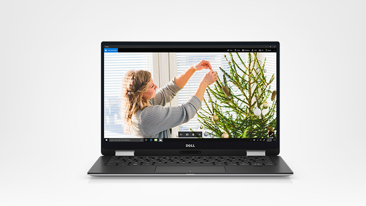 Dell XPS 13 front facing laptop with holiday screenfill