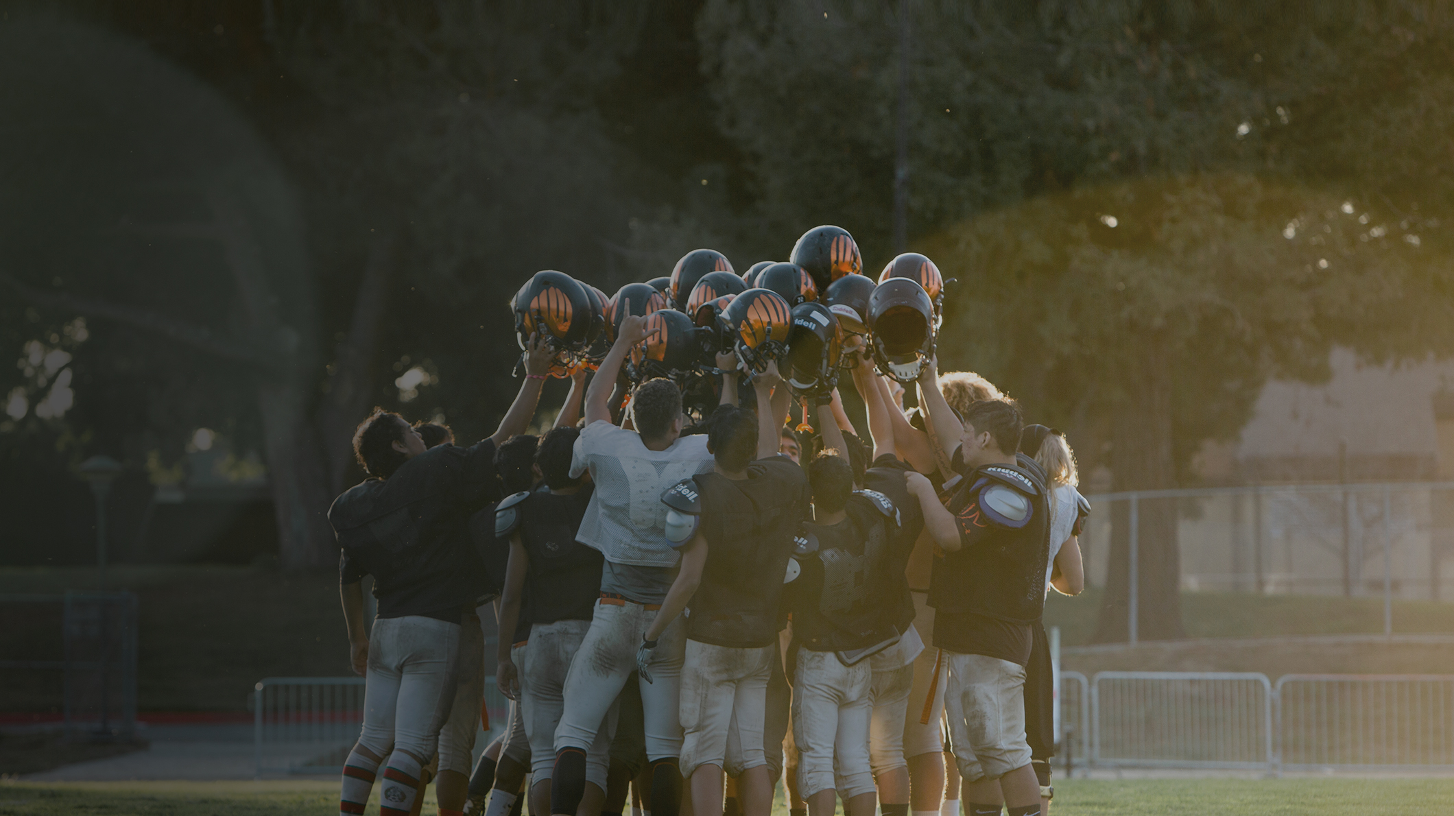 The CSD Eagles football team raises its helmets in the air