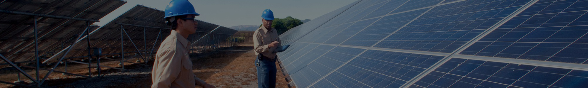 Two workers with tablet evaluating solar panels.
