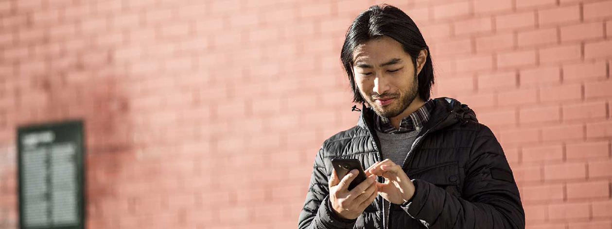 A man checks the notifications on his phone.