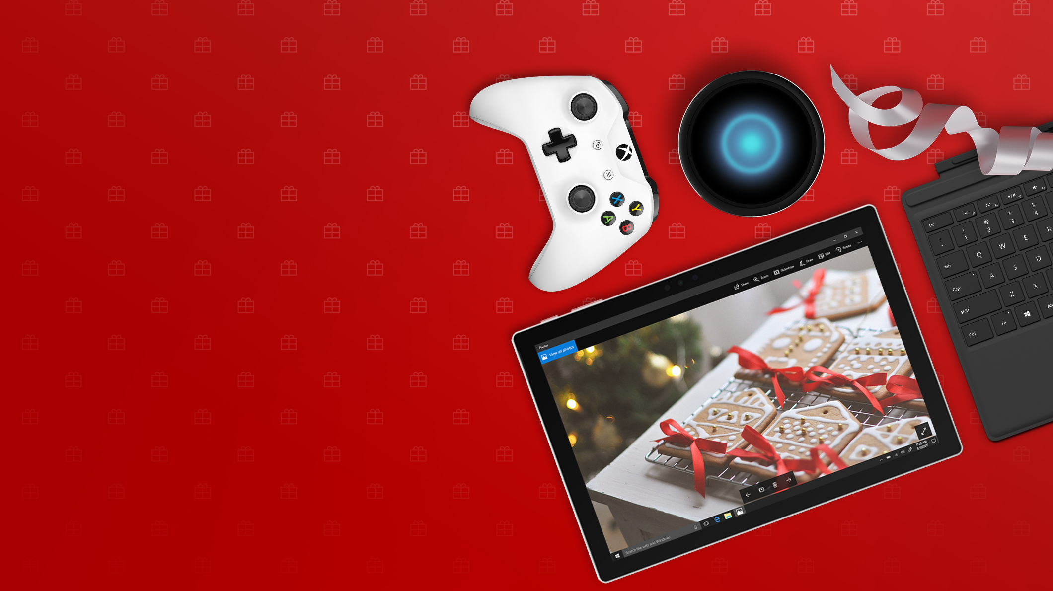 An array of technology including a Surface Pro, Xbox controller, and more
