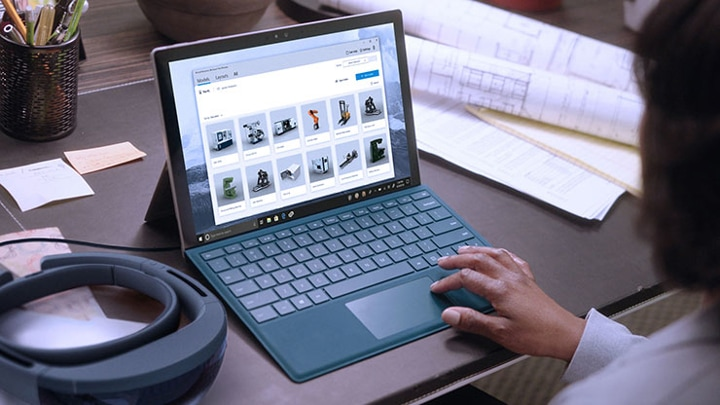 A Worker Using Microsoft Dynamics 365 Layout On His Surface