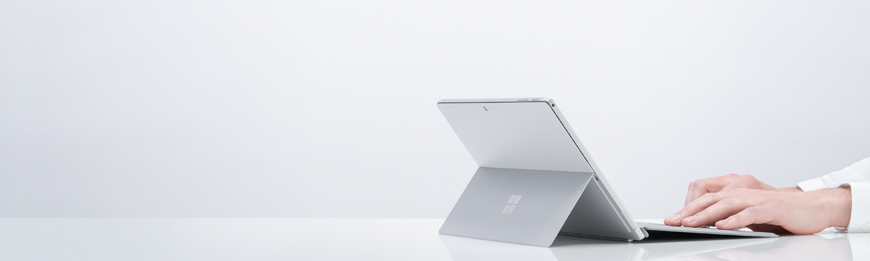Someone typing on a Surface Pro 6 with a Type Cover