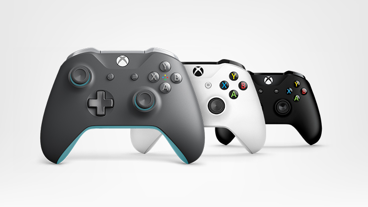 Three Xbox controllers in different colors
