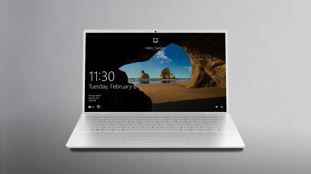 A Windows 10 PC sitting open with the Windows Hello screen displayed