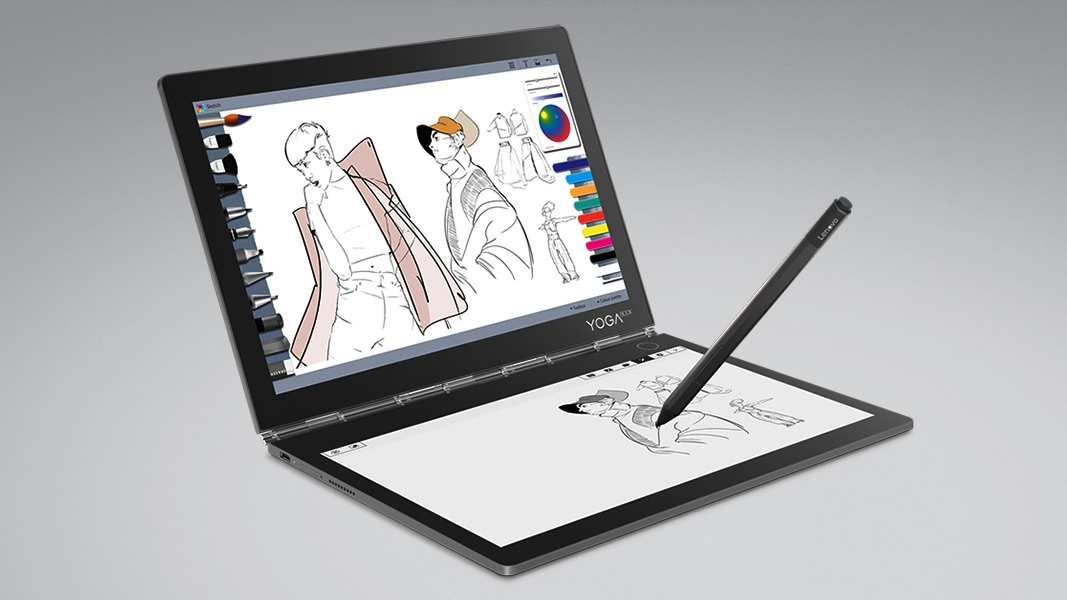 A Lenovo Yoga Book C930 sits open with a dual touchscreen and a pen drawing on the bottom screen