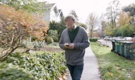 Image alt text A man walking while working from his phone