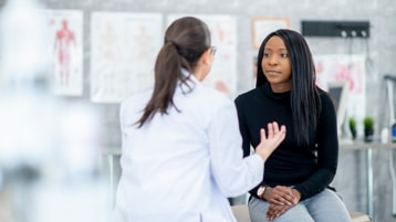 Medical provider consulting with patient