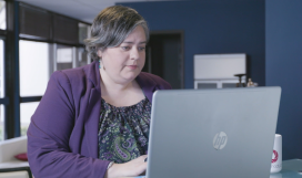 A woman working from a laptop