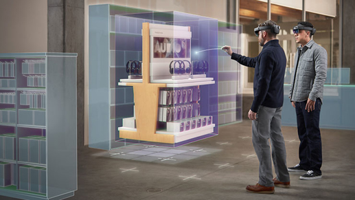 Two coworkers wearing HoloLens 2 headsets looking at a hologram of a headphones sale display