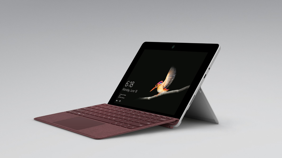 A Surface Go sits in tent mode on a grey background