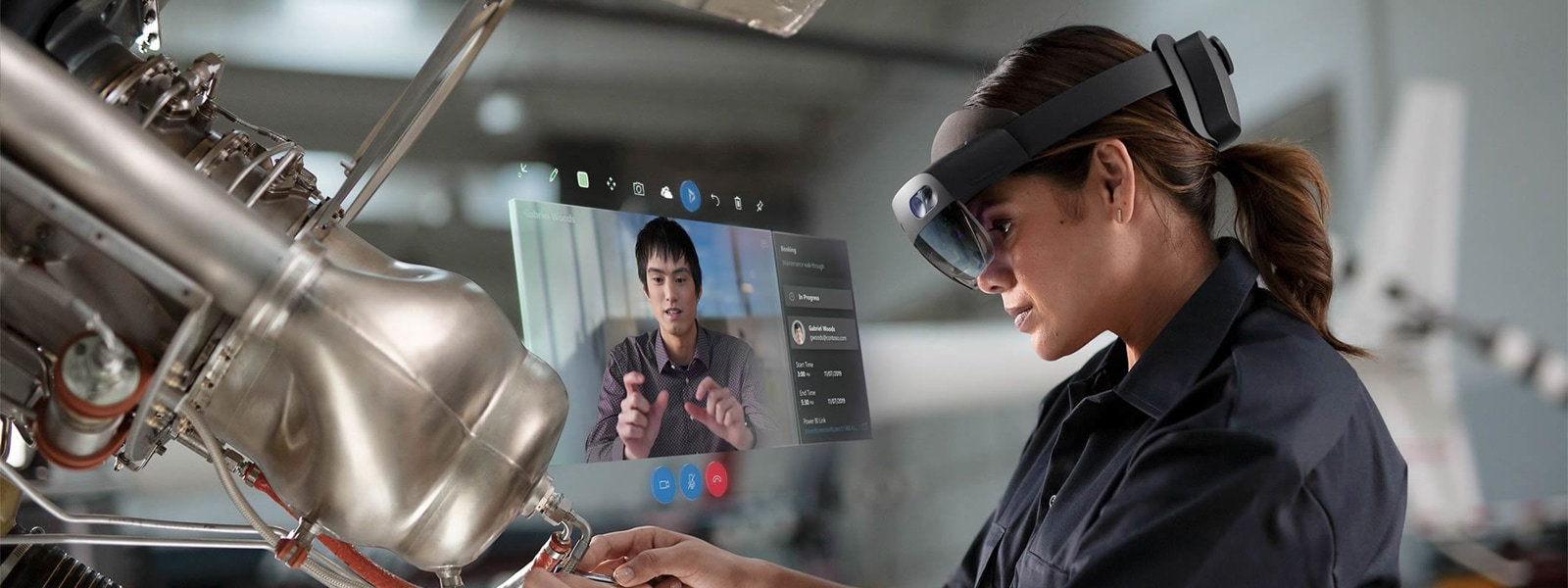 female manufacturing worker wearing HoloLens while working on machinery
