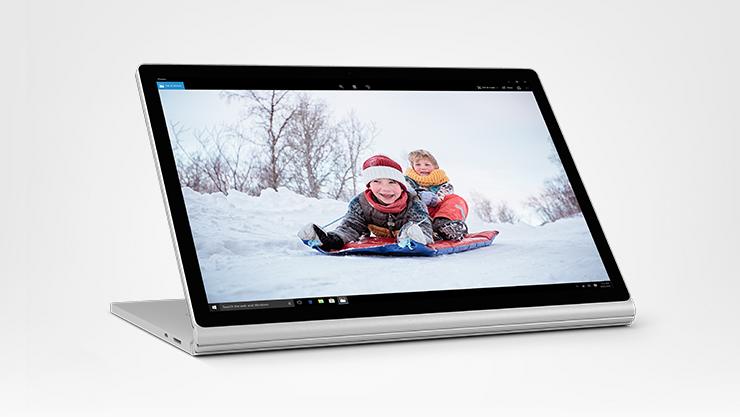 Surface Book 2 displaying an image of children riding a toboggan