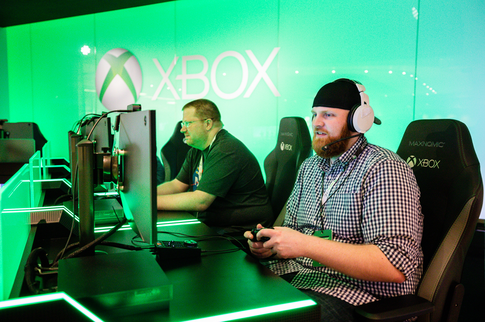 Chief Gaming Officer Experience sweepstakes winner playing Xbox at the Microsoft Visitor Centor