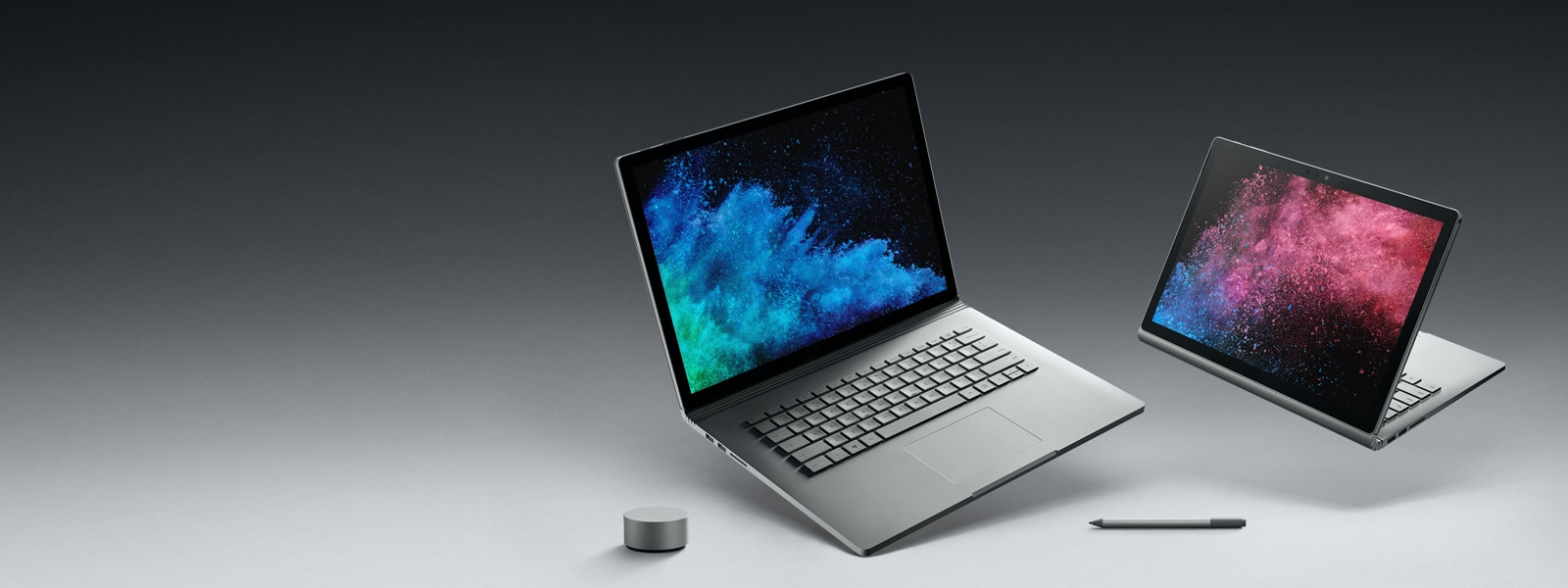 Surface Book 2 in two perspectives, as a laptop and in presentation mode flanked by Surface Dial and Surface Pen