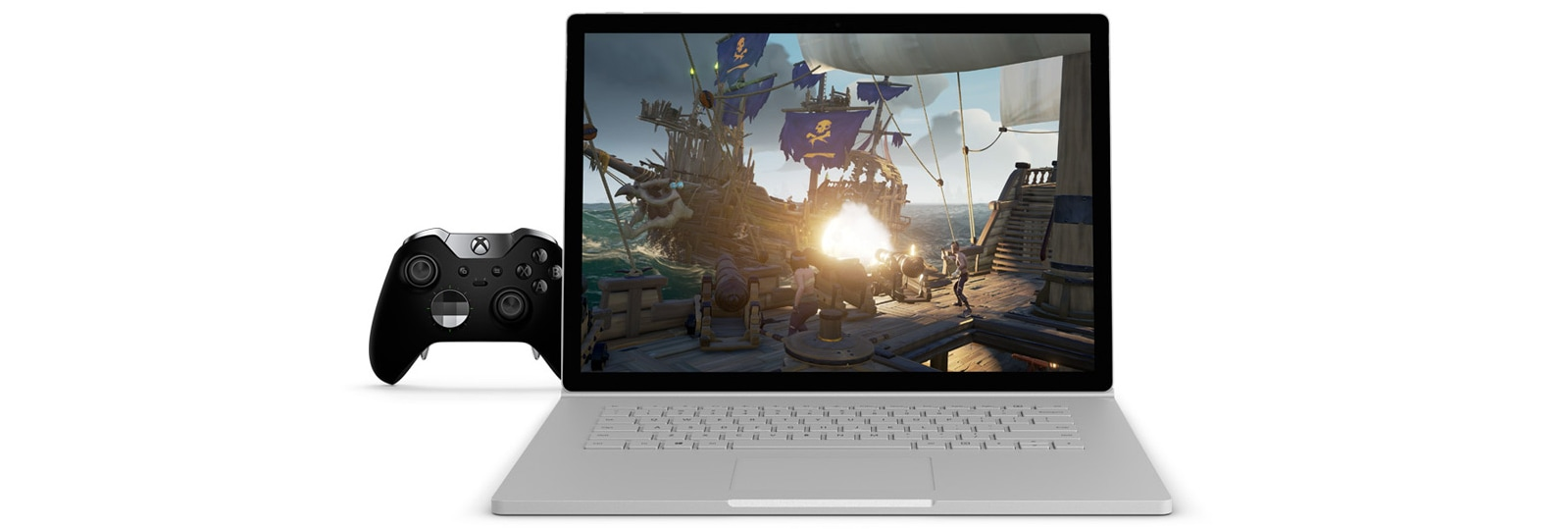 صورة لعبة Sea of Thieves على Surface Book 2 مقاس 15 بوصة محاط بوحدة تحكم Xbox Elite