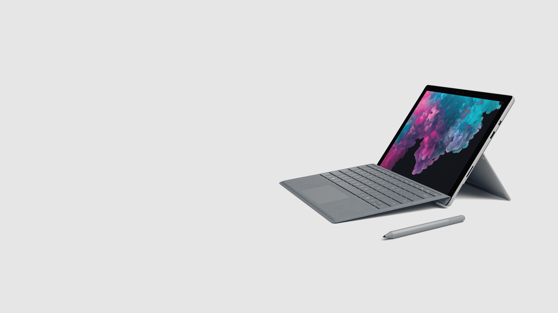 A Surface Pro 6 with a platinum Type Cover and Surface Pen