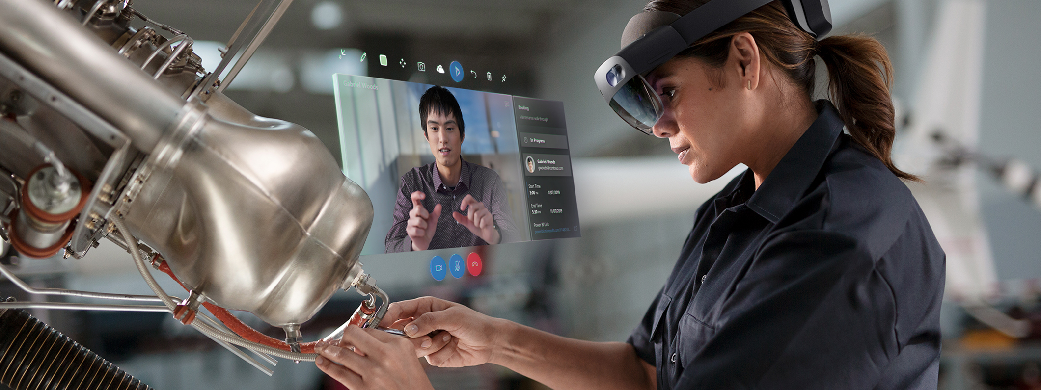 A factory worker wearing a HoloLens 2 headset studying a systems check hologram