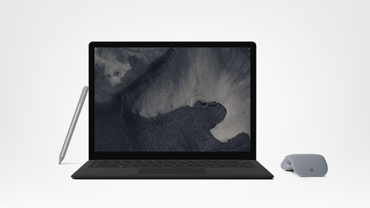 Black Surface Laptop 2 with a pen and mouse
