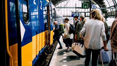 People boarding a commuter train.
