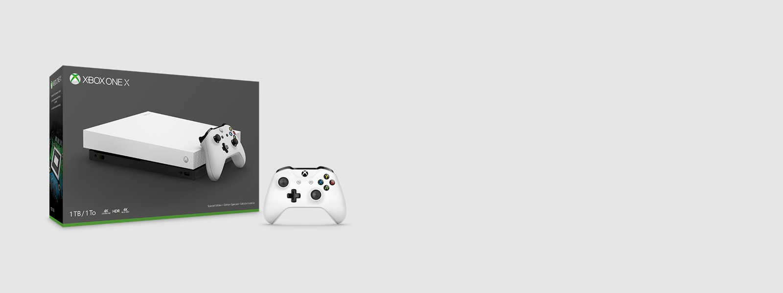 Xbox One X console and white Xbox One controller.