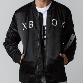 Young adult man wearing Xbox Gear Store Linear Bomber Jacket