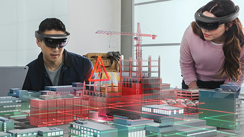 two architects using Microsoft HoloLens to view building construction