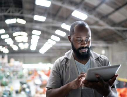 A person looking down at a tablet