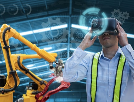 A person using a VR device in a manufacturing setting.