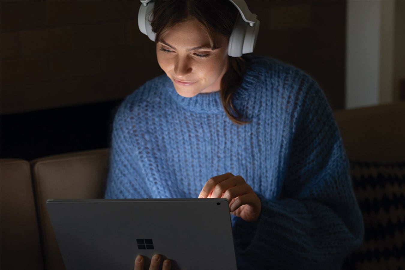 A woman listens to a film with headphones