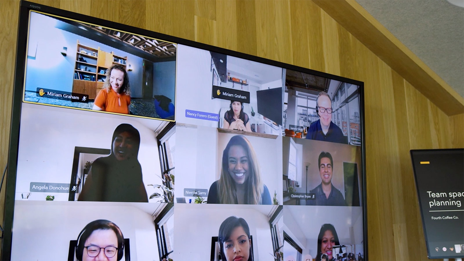 A Teams video call indicating that two of the participants have raised their hand to speak.