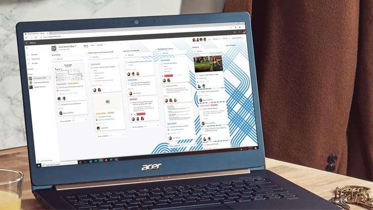 A laptop screen showing a Kanban board in Planner.