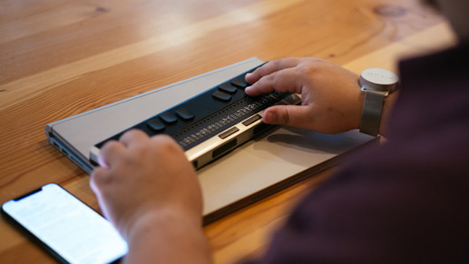 A person using a braille display.